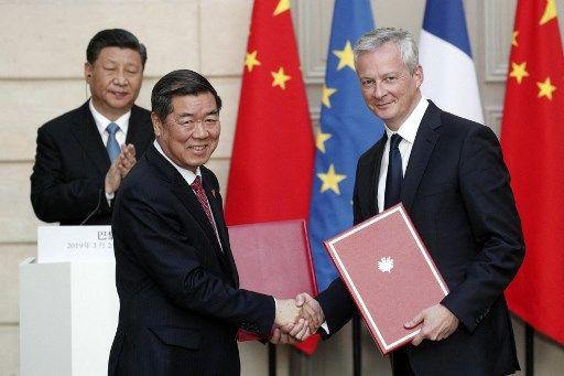 He Lifeng, directeur de la NDRC, en compagnie du ministre de l'Economie français Bruno Le Maire, en 2019.