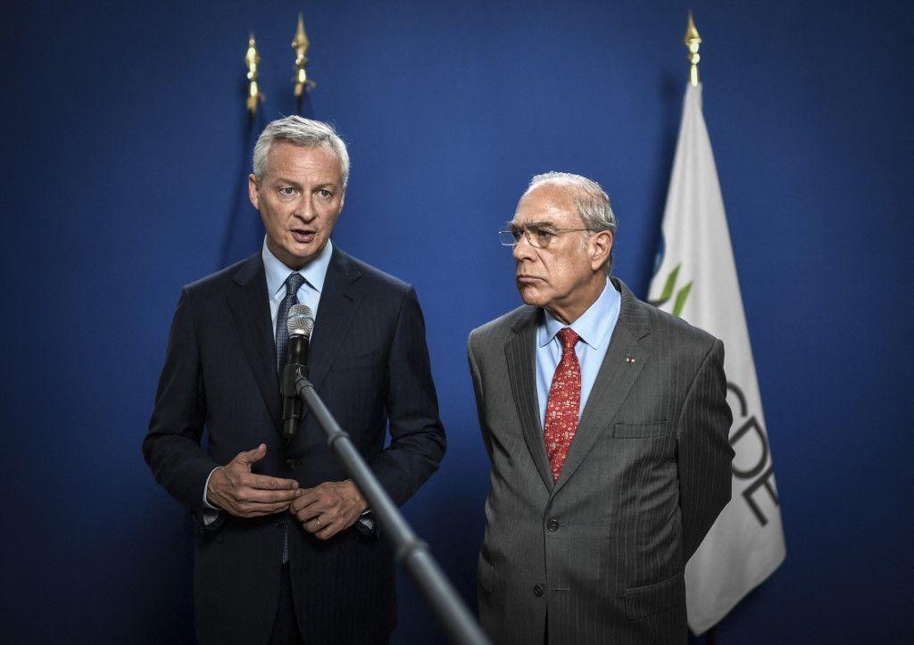 Le ministre de l'Economie et des Finances, Bruno Le Maire, avec le secrétaire général de l'OCDE, José Angel Gurria, lors d'une conférence de presse, le 29 août 2019.
