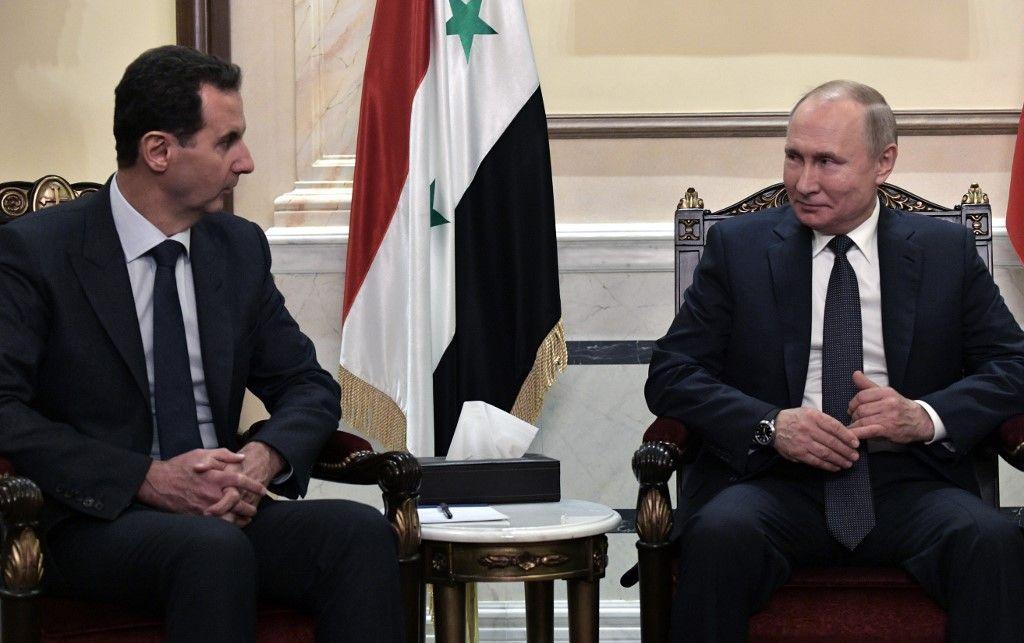 Vladimir Poutine et Bachar el-Assad lors d'une rencontre officielle.