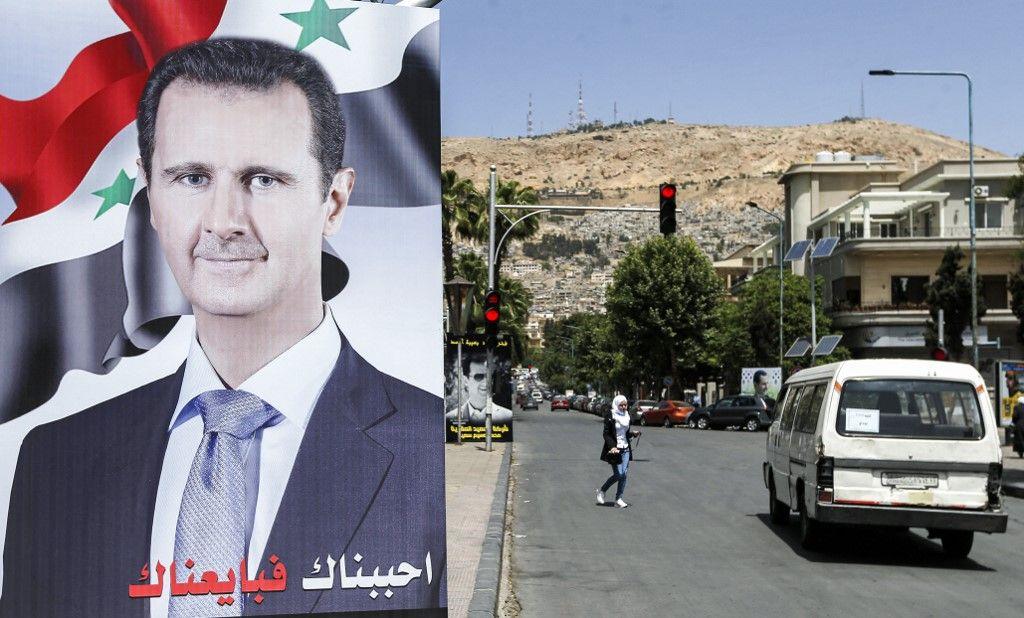 Une grande pancarte avec le portrait du président syrien Bachar el-Assad dans la ville de Damas le 10 mai 2021 avant les élections présidentielles.