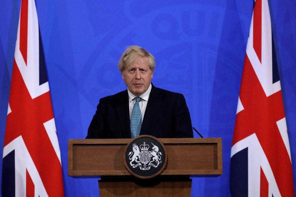 Le Premier ministre britannique Boris Johnson fait le point sur la pandémie de Covid-19 lors d'une conférence de presse, le 14 mai 2021.