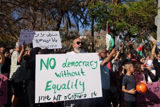 Des manifestants à Jaffa, près de Tel Aviv.