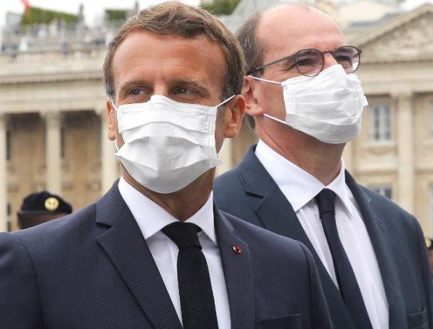 Le président de la République, Emmanuel Macron, et le Premier ministre, Jean Castex, lors d'une cérémonie.