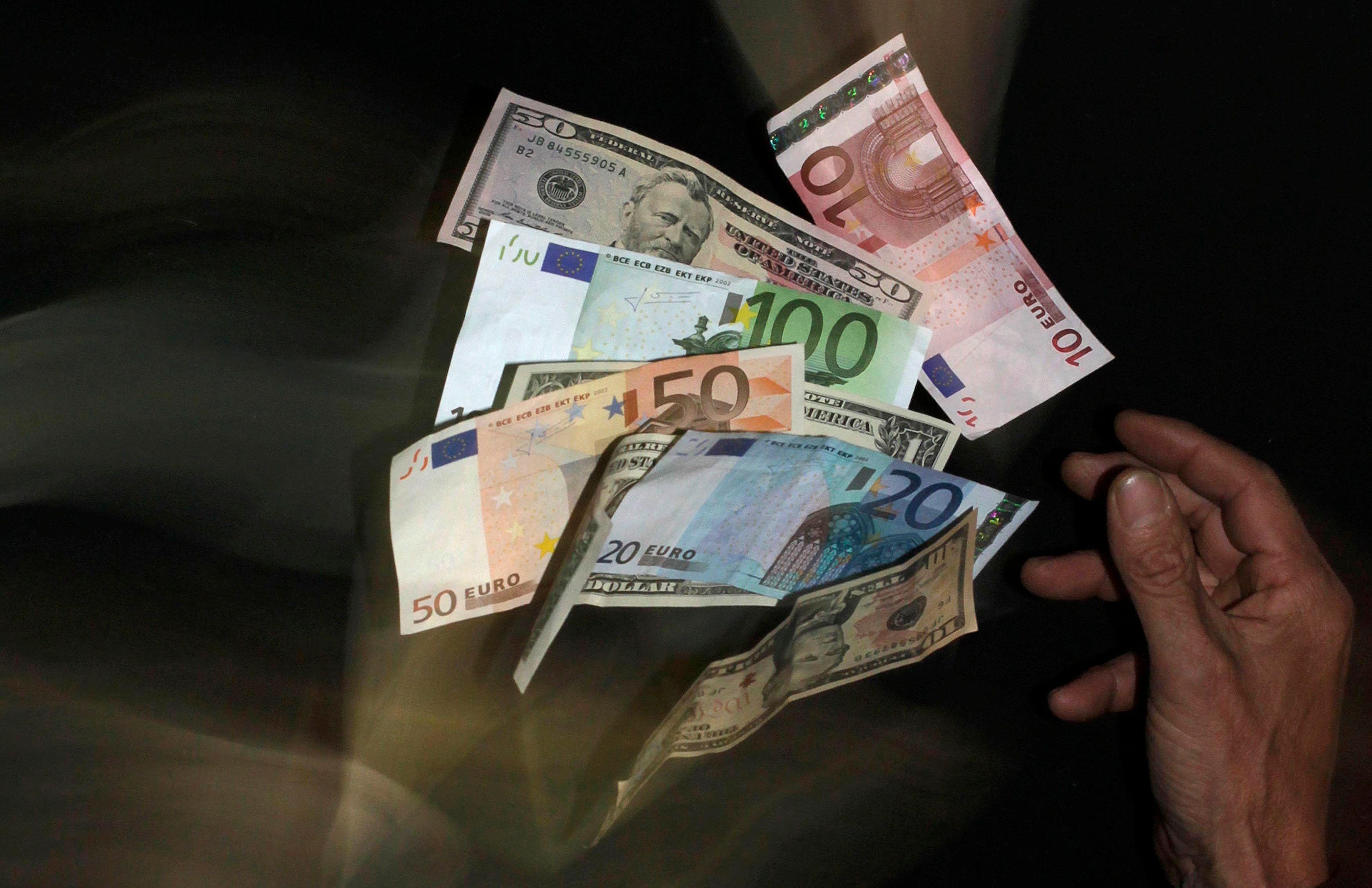 Les chrétiens-démocrates d'Angela Merkel et les sociaux-démocrates ont convenu lundi du principe d'une taxe sur les transactions financières.