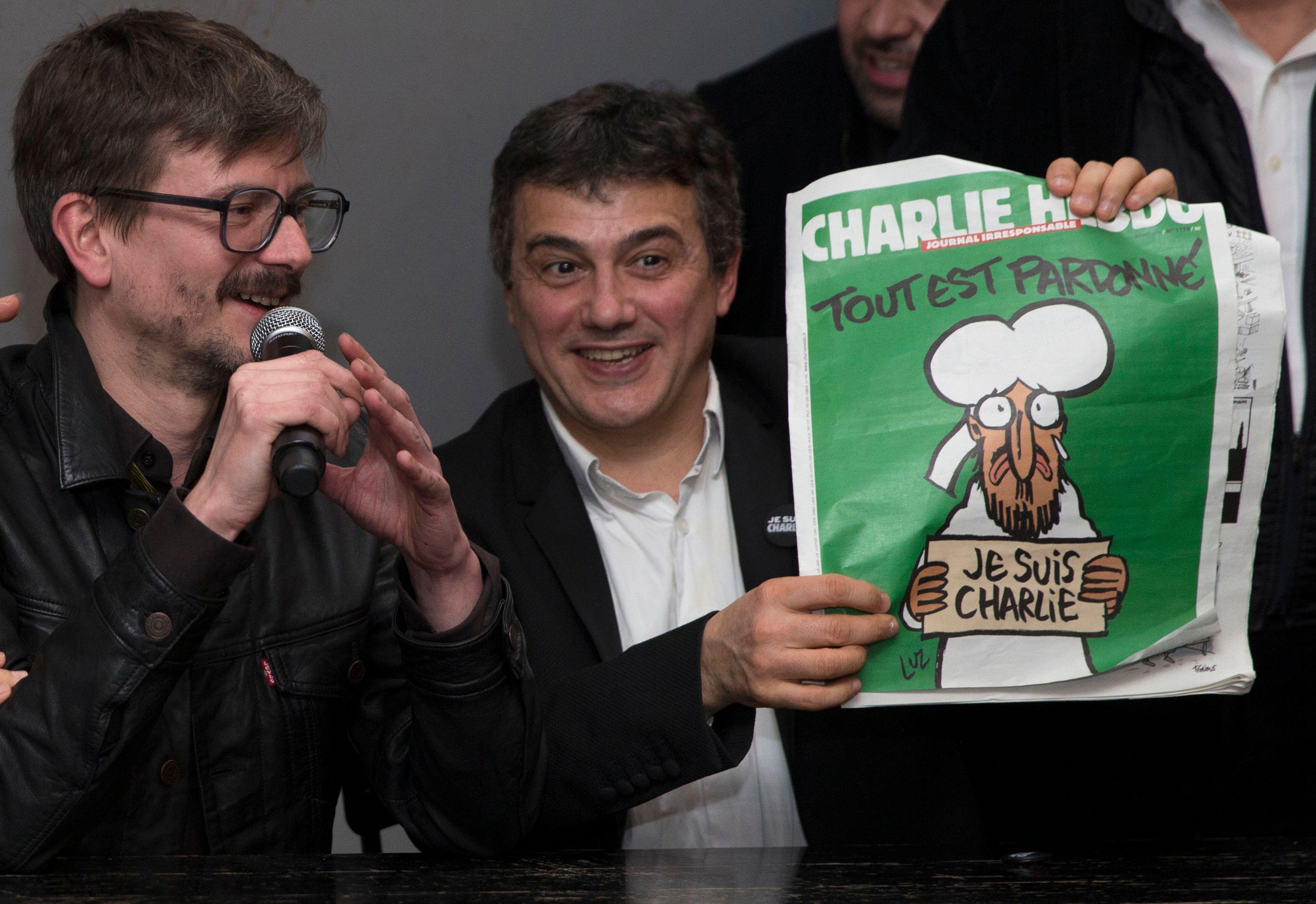 Le dessinateur Luz et le collaborateur de Charlie Hebdo Patrick Pelloux.