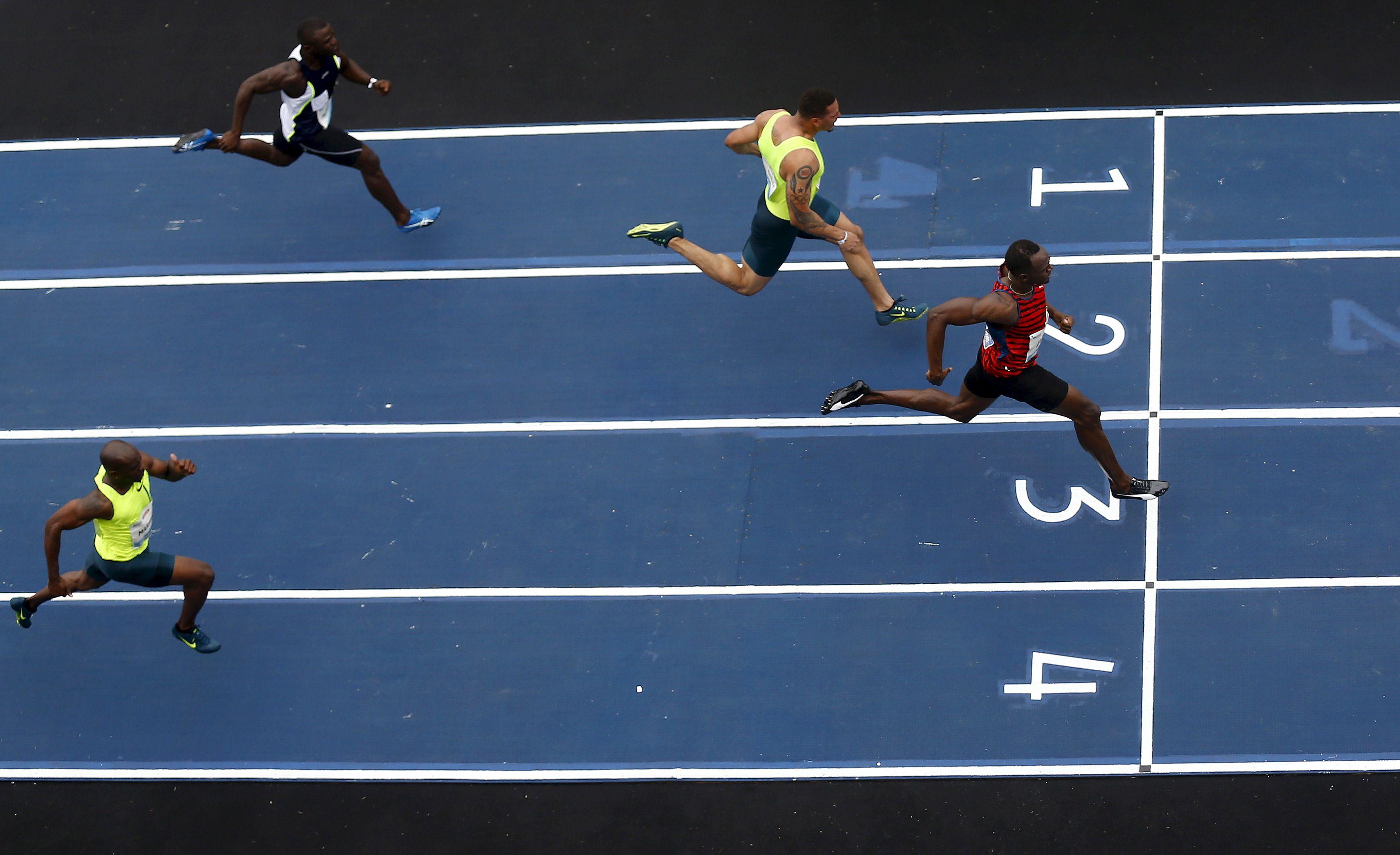 Le champion Usain Bolt (ici gagnant une course), commme la quasi-totalité des meilleurs sprinteurs mondiaux, sont des descendants de populations d'Afrique de l'Ouest, d'où venaient les esclaves du continent américain.