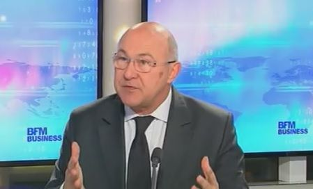 Michel Sapin, ministre du Budget, au micro de BFM Business